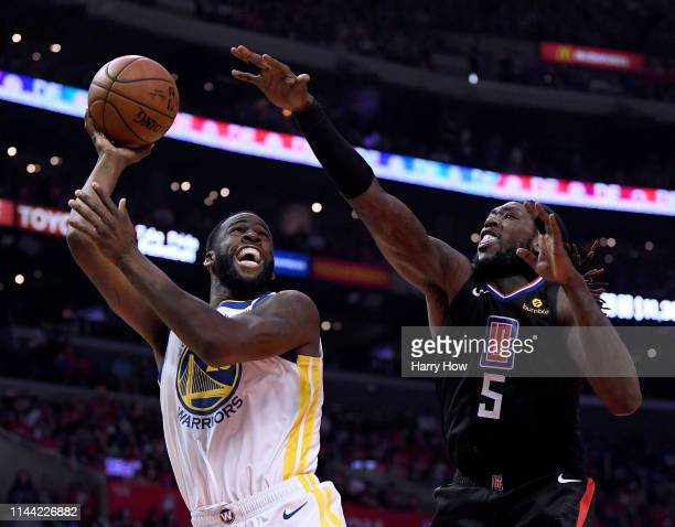 Draymond Green of the Golden State Warriors scores in front of Montrezl Harrell of the LA Clippers during a 113105 Warrior win in Game Four of Round...