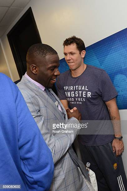 Draymond Green of the Golden State Warriors shakes hands with assistant coach Luke Walton before facing the Cleveland Cavaliers for Game Two of the...