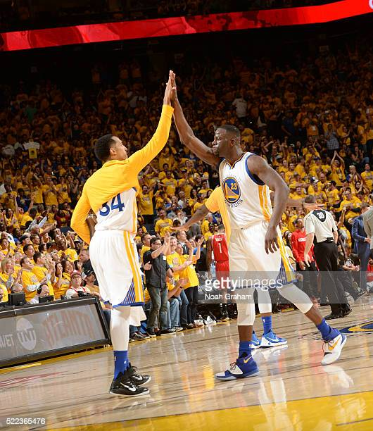 Draymond Green of the Golden State Warriors shakes hands with Shaun Livingston of the Golden State Warriors during the game against the Houston...