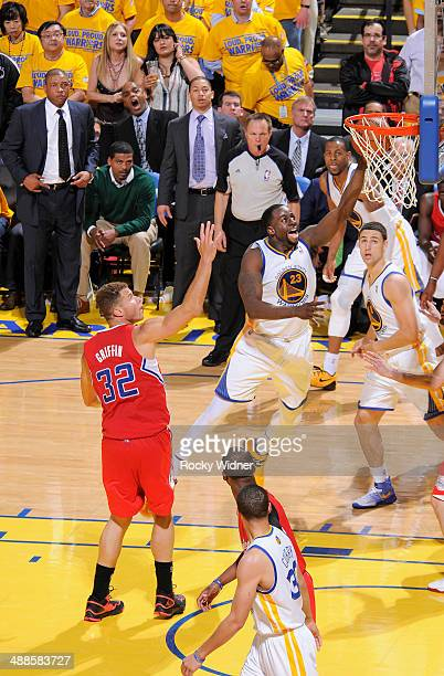Draymond Green of the Golden State Warriors shoots a layup against Blake Griffin of the Los Angeles Clippers in Game Six of the Western Conference...