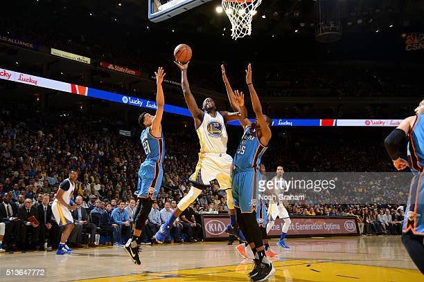 Draymond Green of the Golden State Warriors shoots a layup during the game against the Oklahoma City Thunder on March 3 2016 at ORACLE Arena in...