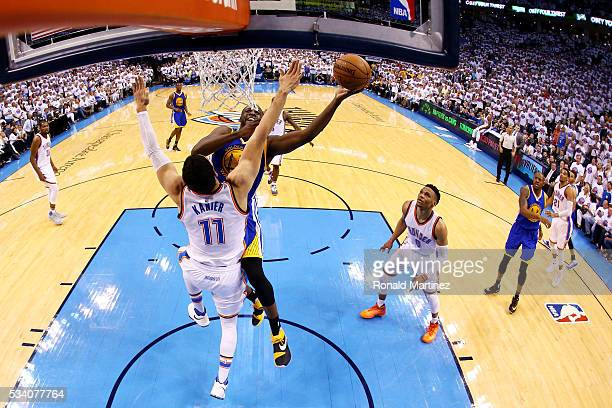 Draymond Green of the Golden State Warriors shoots against Enes Kanter of the Oklahoma City Thunder in the second half in game four of the Western...