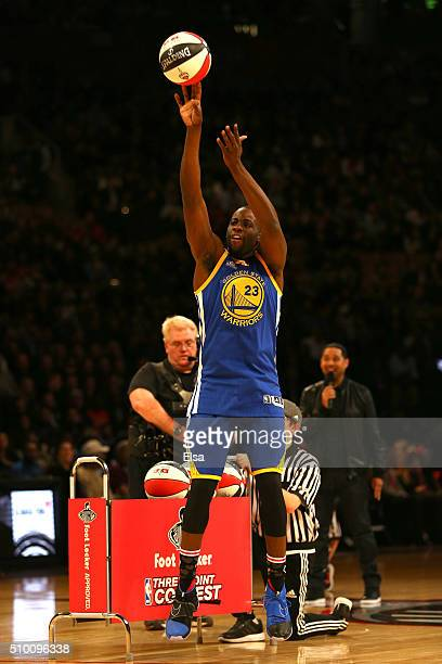 Draymond Green of the Golden State Warriors shoots during a three point contest against actor Kevin Hart before the Foot Locker ThreePoint Contest...