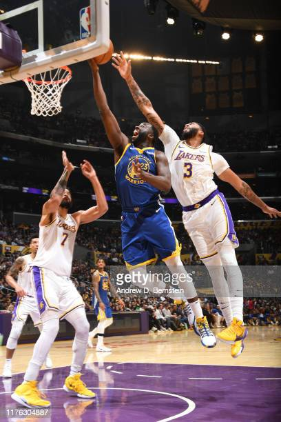 Draymond Green of the Golden State Warriors shoots the ball against Anthony Davis of the Los Angeles Lakers during a preseason game on October 16...
