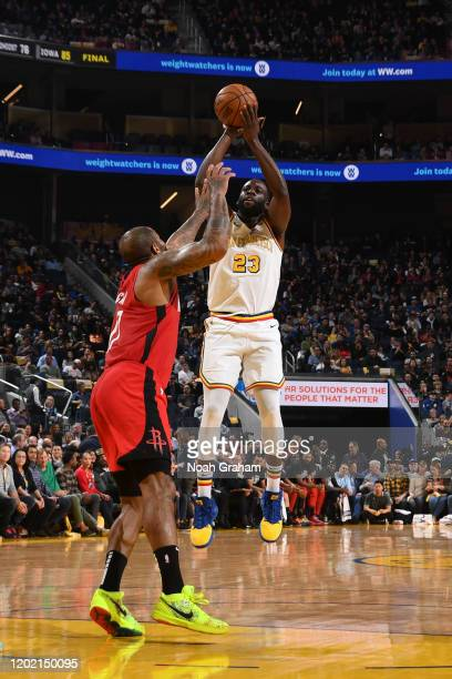 Draymond Green of the Golden State Warriors shoots the ball against the Houston Rockets on February 20 2020 at Chase Center in San Francisco...