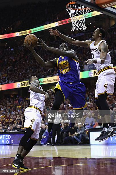 Draymond Green of the Golden State Warriors shoots the ball against Channing Frye of the Cleveland Cavaliers during the first half in Game 4 of the...