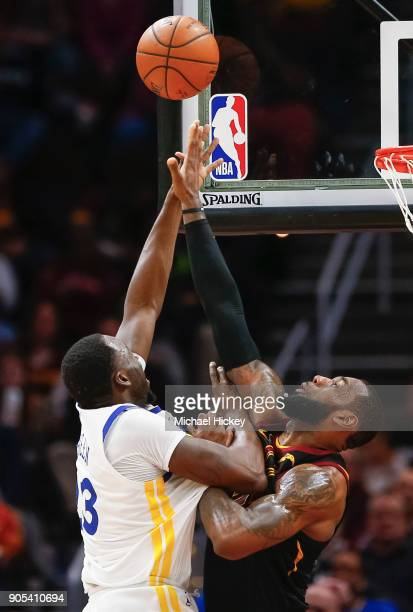Draymond Green of the Golden State Warriors shoots the ball against LeBron James of the Cleveland Cavaliers at Quicken Loans Arena on January 15 2018...