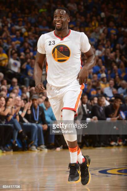 Draymond Green of the Golden State Warriors smiles and runs up court during the game against the Chicago Bulls on February 8 2017 at ORACLE Arena in...