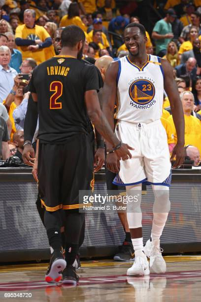 Draymond Green of the Golden State Warriors smiles and talks to Kyrie Irving of the Cleveland Cavaliers in Game Five of the 2017 NBA Finals on June...