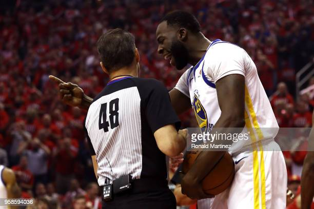 Draymond Green of the Golden State Warriors speaks to referee Scott Foster after being called for a foul in the first quarter against the Houston...