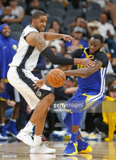 Draymond Green of the Golden State Warriors steals the ball from LaMarcus Aldridge of the San Antonio Spurs at ATT Center on April 19 2018 in San...