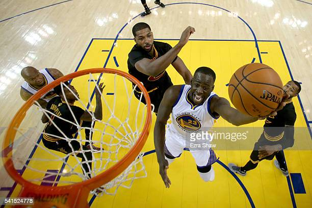Draymond Green of the Golden State Warriors takes a shot against Tristan Thompson of the Cleveland Cavaliers in Game 7 of the 2016 NBA Finals at...