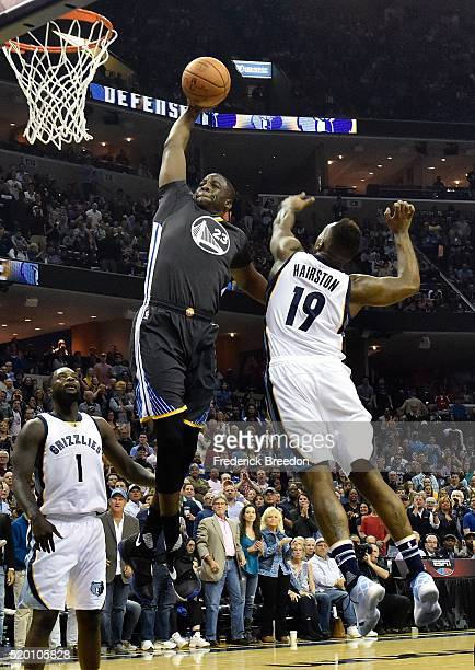 Draymond Green of the Golden State Warriors takes a shot against PJ Hairston of the Memphis Grizzlies during the second half at FedExForum on April 9...