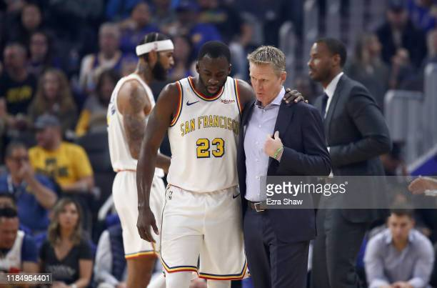 Draymond Green of the Golden State Warriors talks to head coach Steve Kerr during their game against the San Antonio Spurs at Chase Center on...