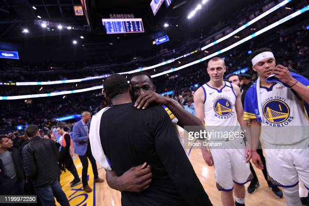 Draymond Green of the Golden State Warriors talks with Andre Iguodala of the Miami Heat after the game on February 10 2020 at Chase Center in San...