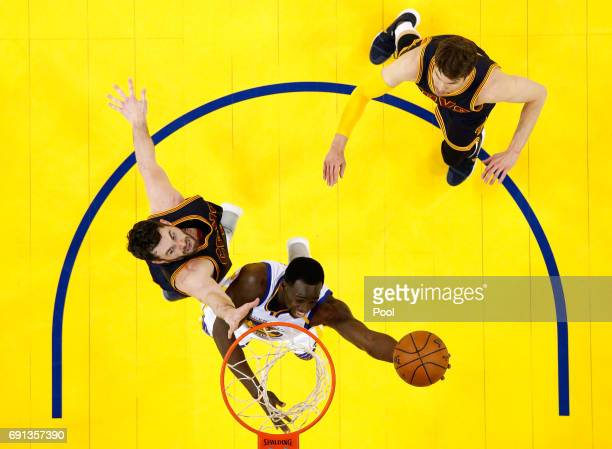 Draymond Green of the Golden State Warriors throws up a shot against Kevin Love of the Cleveland Cavaliers in Game 1 of the 2017 NBA Finals at ORACLE...