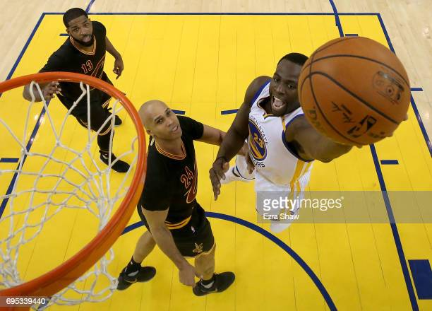 Draymond Green of the Golden State Warriors throws up a shot against Richard Jefferson of the Cleveland Cavaliers in Game 5 of the 2017 NBA Finals at...