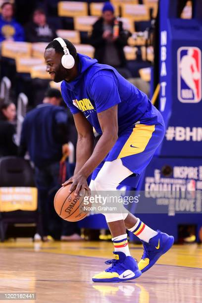 Draymond Green of the Golden State Warriors warms up before the game against the Houston Rockets on February 20 2020 at Chase Center in San Francisco...