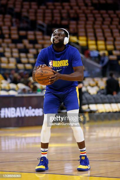 Draymond Green of the Golden State Warriors warms up before the game against the Houston Rockets at Chase Center on February 20 2020 in San Francisco...