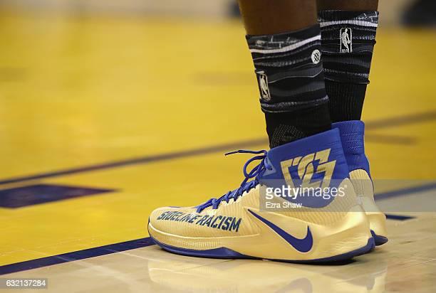 Draymond Green of the Golden State Warriors wears Nike shoes that say 'Sideline Racism' during their game against the Cleveland Cavaliers at ORACLE...