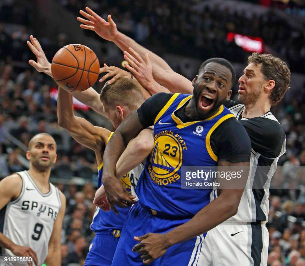 Draymond Green of the Golden State Warriors yells after battling Davis Bertans of the San Antonio Spurs and Pau Gasol of the San Antonio Spurs for a...