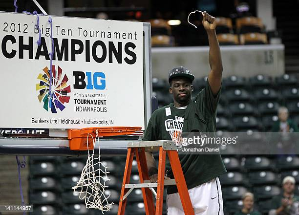 Draymond Green of the Michigan State Spartans celebrates after he cut down a piece of the net following their 68-64 win against the Ohio State...