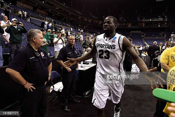 Draymond Green of the Michigan State Spartans high fives the crowd as he runs off the court after defeating the St Louis Billikens during the third...