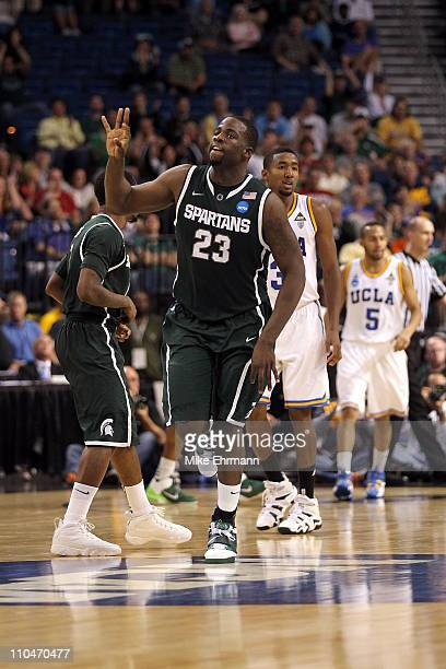 Draymond Green of the Michigan State Spartans reacts after he made a 3-point shot in the second half against the UCLA Bruins during the second round...