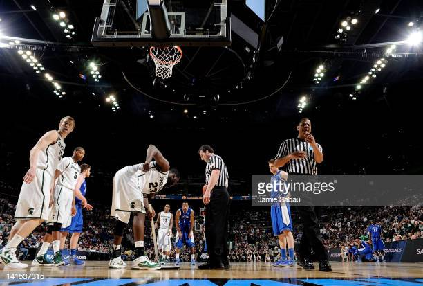 Draymond Green of the Michigan State Spartans wipes sweat off the floor late in the second half against the St. Louis Billikens during the third...