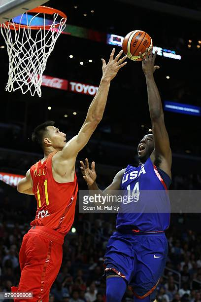 Draymond Green of the United States shoots against Yi Jianlian of China during a USA Basketball showcase exhibition gameat Staples Center on July 24...