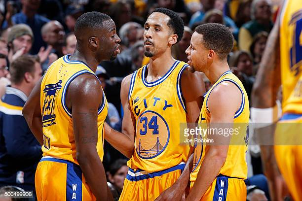 Draymond Green Shaun Livingston and Stephen Curry of the Golden State Warriors react against the Indiana Pacers in the second half of the game at...