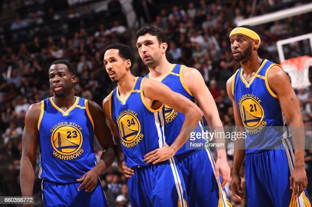 Draymond Green Shaun Livingston Zaza Pachulia and Ian Clark of the Golden State Warriors react to a play against the San Antonio Spurs during the...