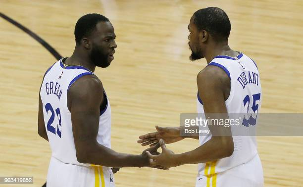 Draymond Green talks with Kevin Durant of the Golden State Warriors in the first quarter of Game Seven of the Western Conference Finals of the 2018...