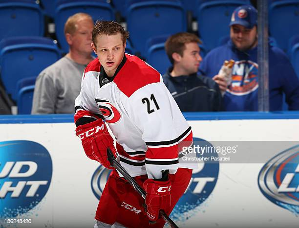Drayson Bowman of the Carolina Hurricanes skates prior to the game against the New York Islanders on October 19 2013 at the Nassau Veterans Memorial...