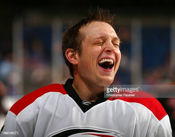 Drayson Bowman of the Carolina Hurricanes smiles prior to the game against the New York Islanders on October 19 2013 at the Nassau Veterans Memorial...