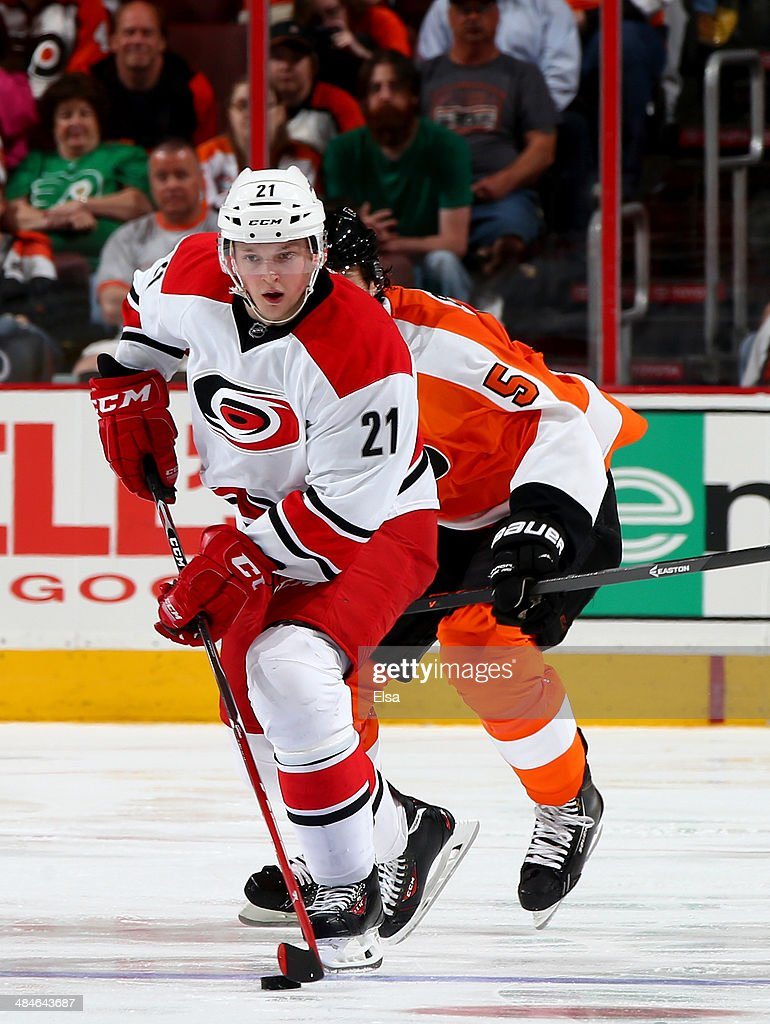 Drayson Bowman #21 of the Carolina Hurricanes takes the puck as Braydon Coburn #5 of the Philadelphia Flyers defends at Wells Fargo Center on April 13, 2014 in Philadelphia, Pennsylvania.The Carolina Hurricanes defeated the Philadelphia Flyers 6-5 in an overtime shootout.
