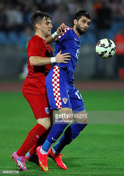 Drazen Bagaric of Croatia vies with Luke Shaw of England during the UEFA U21 Championship Playoff Second Leg match between Croatia and England at the...