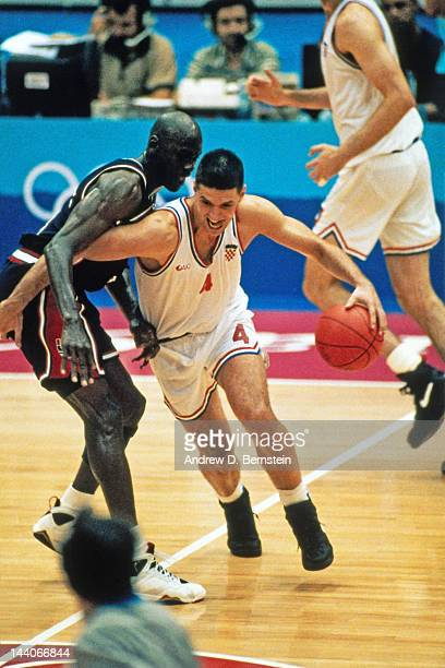 Drazen Petrovic of Croatia dribbles against Michael Jordan of the United States during the 1992 Olympics on August 8 1992 at the Palau Municipal...
