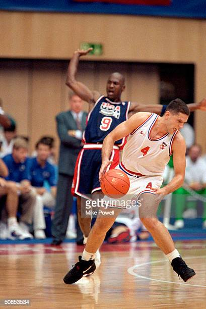 Drazen Petrovic of Croatia is covered by Michael Jordan of the United States during the 1992 Olympic game on July 27 1992 in Barcelona Spain The...