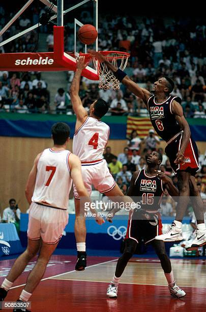 Drazen Petrovic of Croatia lays the ball up over Scottie Pippen of the United States during the 1992 Olympic game on July 27 1992 in Barcelona Spain...