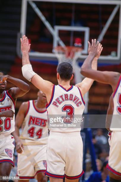 Drazen Petrovic of the New Jersey Nets celebrates against the Atlanta Hawks during a game played circa 1993 at the Brendan Byrne Arena in East...