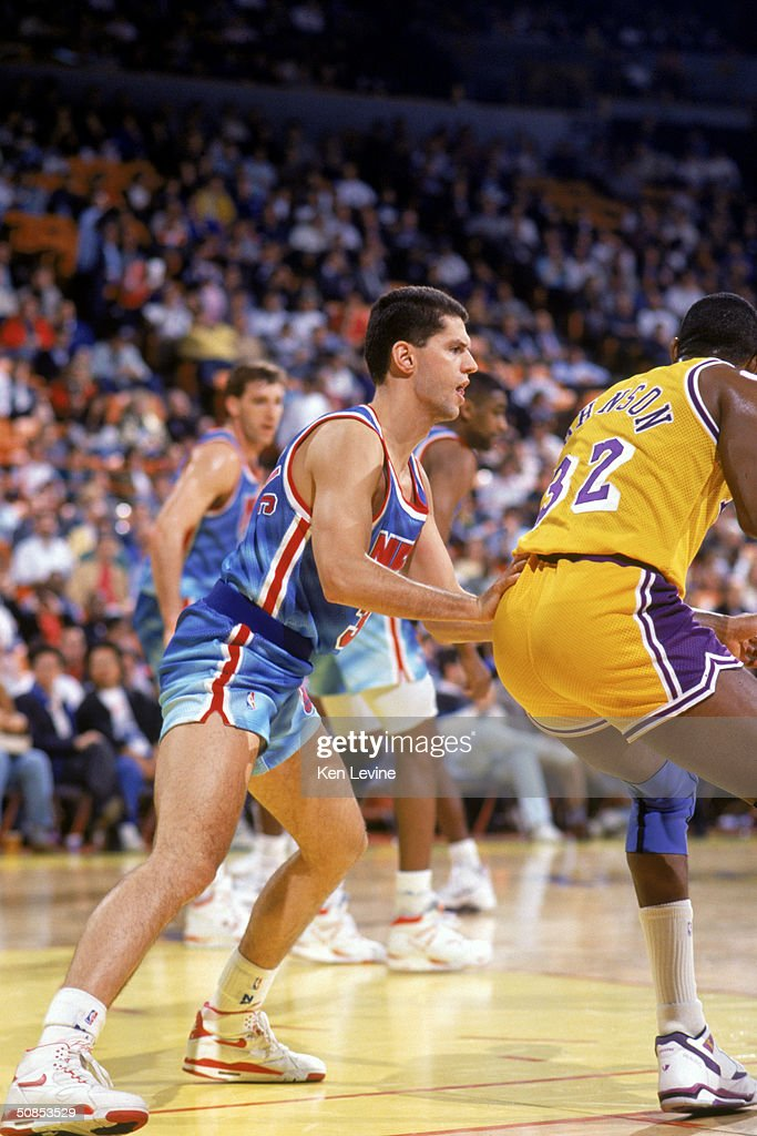 949fef61d Drazen Petrovic of the New Jersey Nets covers Earvin Magic Johnson ...