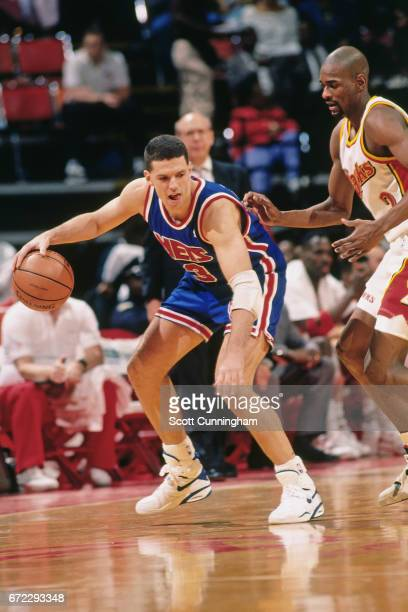 Drazen Petrovic of the New Jersey Nets dribbles against the Atlanta Hawks during a game played circa 1990 at the Omni in Atlanta Georgia NOTE TO USER...