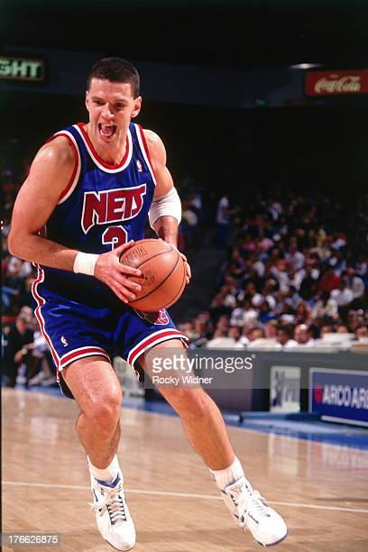 b619f5b6757 Drazen Petrovic of the New Jersey Nets dribbles the ball against the Sacramento  Kings on November