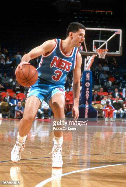 Drazen Petrovic of the New Jersey Nets dribbles the ball against the Washington Bullets during an NBA basketball game circa 1991 at the Capital...