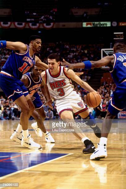 Drazen Petrovic of the New Jersey Nets dribbles to the basket against John Hot Rod Williams of the Cleveland Cavaliers during Game Three of the...
