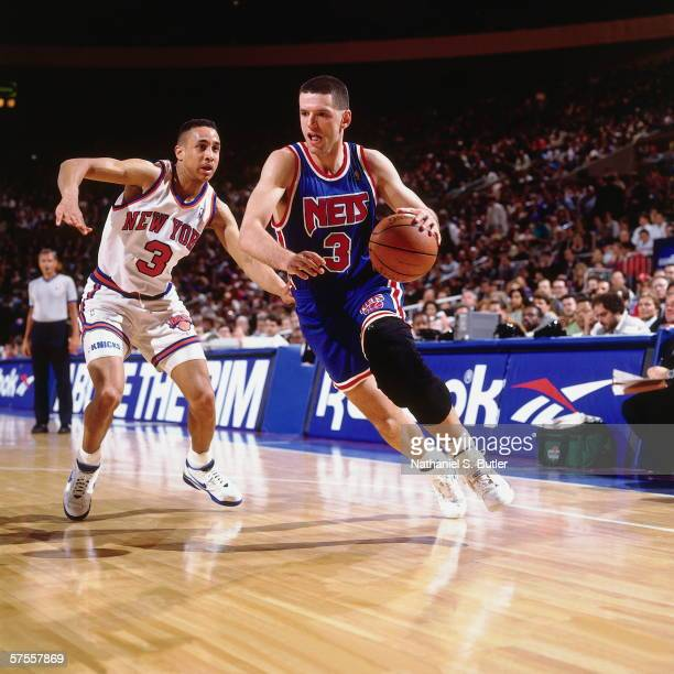 Drazen Petrovic of the New Jersey Nets drives to the basket against John Starks of the New York Knicks during a game at Madison Square Garden on...