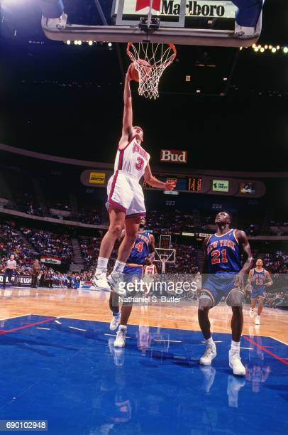Drazen Petrovic of the New Jersey Nets goes for a dunk during the game against the New York Knicks circa 1993 at the Brendan Byrne Arena in East...
