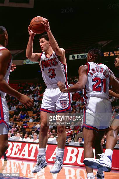 Drazen Petrovic of the New Jersey Nets grabs a rebound circa 1991 at Brendan Byrne Arena in East Rutherford NJ NOTE TO USER User expressly...