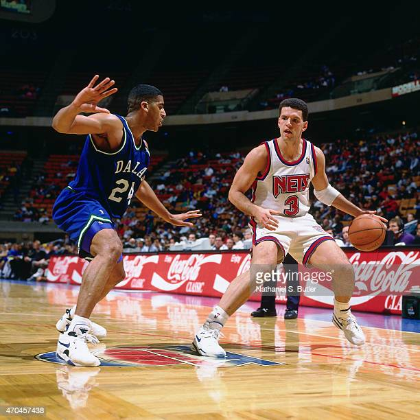 Drazen Petrovic of the New Jersey Nets handles the ball against Jim Jackson of the Dallas Mavericks circa 1992 at the Continental Airlines Arena in...